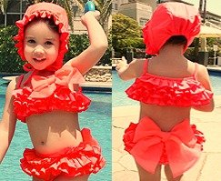 dottig-hippeshops-bikini oranje met roezels en strikken-